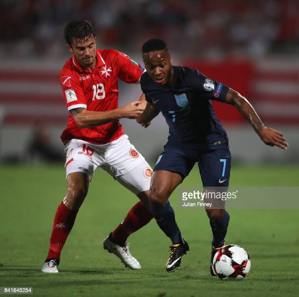 Raheem Sterling of England holds off Bjorn Kristensen of Malta during the FIFA 2018 World Cup Qualifier between Malta and England at Ta'Qali National...