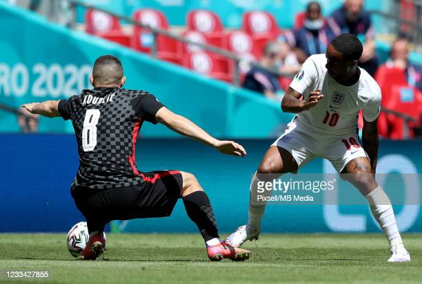 Raheem Sterling of England in action against Mateo Kovacic of Croatiaduring the UEFA Euro 2020 Championship Group D match between England and Croatia...