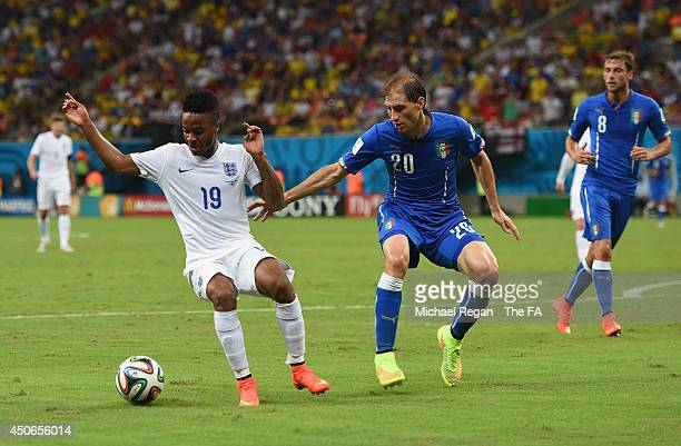 Raheem Sterling of England in action with Gabriel Paletta of Italy during the 2014 FIFA World Cup Brazil Group D match between England and Italy at...