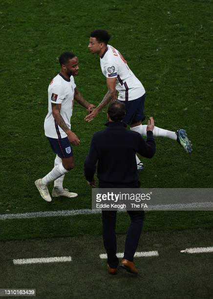 Raheem Sterling of England interacts with Jesse Lingard of England as he is substituted during the FIFA World Cup 2022 Qatar qualifying match between...