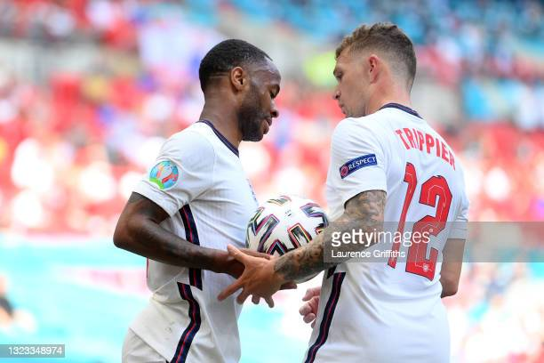 Raheem Sterling of England interacts with team mate Kieran Trippier during the UEFA Euro 2020 Championship Group D match between England and Croatia...