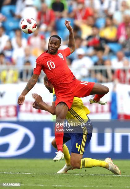 Raheem Sterling of England is challenged by Andreas Granqvist of Sweden during the 2018 FIFA World Cup Russia Quarter Final match between Sweden and...
