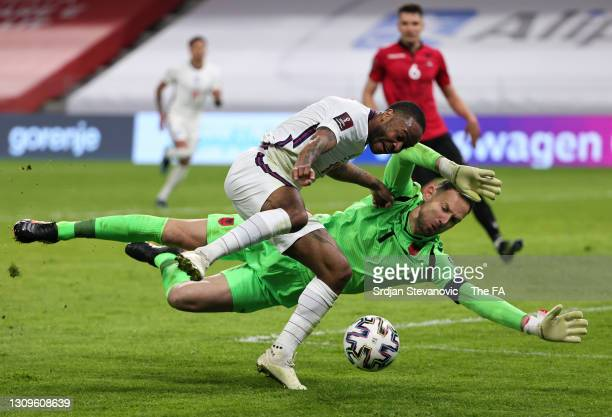 Raheem Sterling of England is challenged by Etrit Berisha of Albania during the FIFA World Cup 2022 Qatar qualifying match between Albania and...