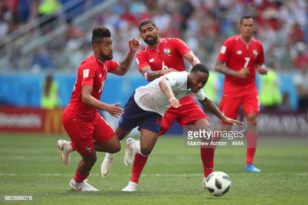 Raheem Sterling of England is challenged by Gabriel Gomez and Anibal Godoy of Panama during the 2018 FIFA World Cup Russia group G match between...