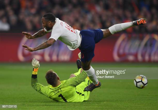 Raheem Sterling of England is challenged by Jeroen Zoet of the Netherlands during the International Friendly match between Netherlands and England at...