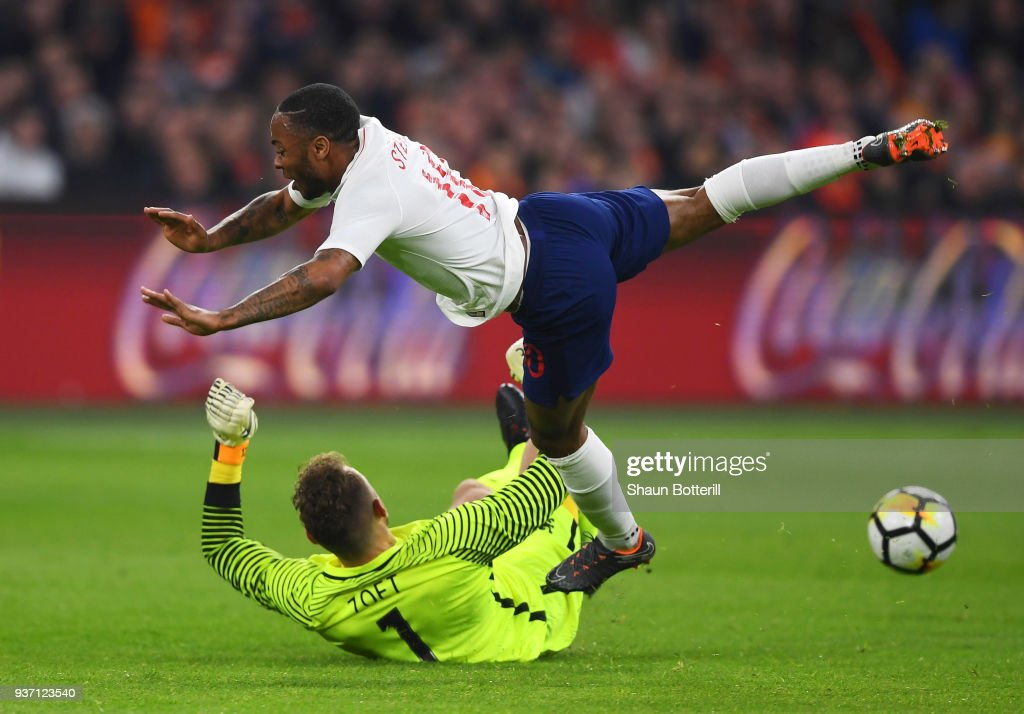 Raheem Sterling of England is challenged by Jeroen Zoet of the Netherlands during the international friendly match between Netherlands and England at Johan Cruyff Arena on March 23, 2018 in Amsterdam, Netherlands.