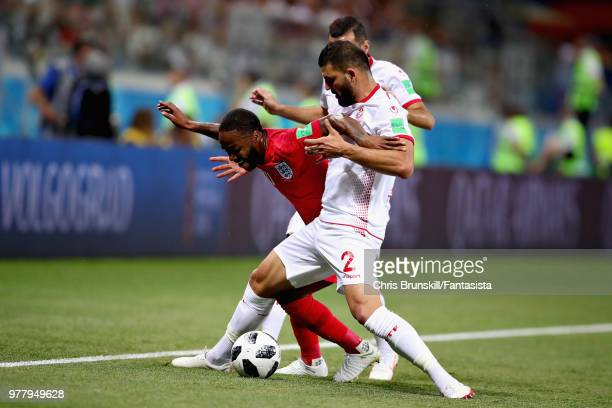 Raheem Sterling of England is challenged by Syam Ben Youssef of Tunisia during the 2018 FIFA World Cup Russia group G match between Tunisia and...