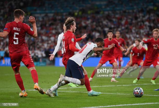 Raheem Sterling of England is fouled by Mathias Jensen of Denmark inside the penalty area, leading to England being awarded a penalty during the UEFA...
