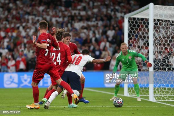 Raheem Sterling of England is fouled by Mathias Jensen of Denmark leading to a penalty being awarded during the UEFA Euro 2020 Championship...