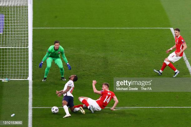 Raheem Sterling of England is fouled by Michal Helik of Poland leading to a penalty being awarded during the FIFA World Cup 2022 Qatar qualifying...
