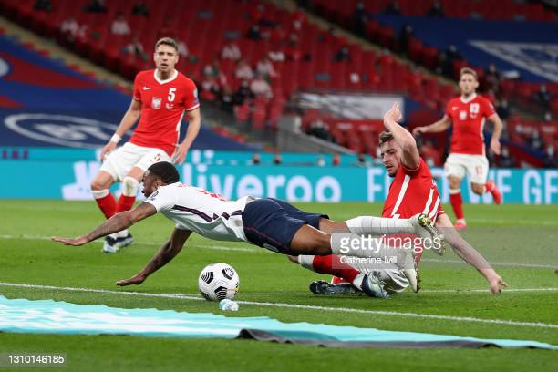 Raheem Sterling of England is fouled by on Michal Helik of Poland leading to a penalty being awarded during the FIFA World Cup 2022 Qatar qualifying...