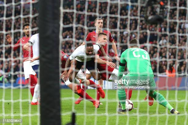 Raheem Sterling of England is fouled in the box by Tomas Kalas and Ondrej Celustka of Czech resulting in a penalty during the 2020 UEFA European...
