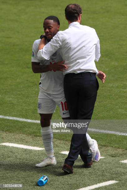 Raheem Sterling of England is greeted by Gareth Southgate, Head Coach of England as he is substituted off during the UEFA Euro 2020 Championship...