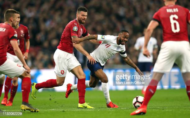 Raheem Sterling of England is held by Ondrej Celustka of Czech during the 2020 UEFA European Championships qualifying match between England and Czech...