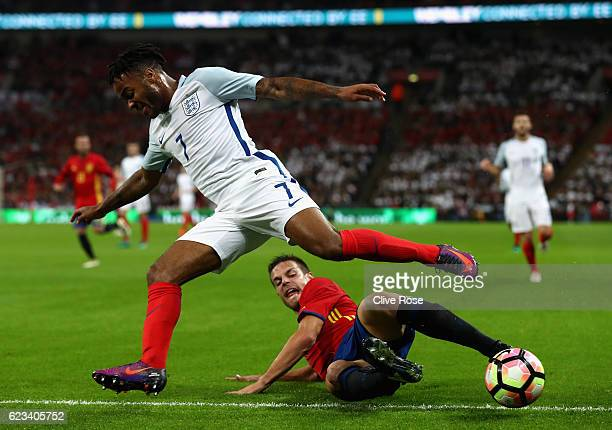 Raheem Sterling of England is tackled by Cesar Azpilicueta of Spain during the international friendly match between England and Spain at Wembley...