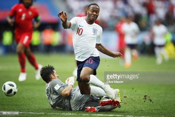 Raheem Sterling of England is tackled by Jaime Penedo during the 2018 FIFA World Cup Russia group G match between England and Panama at Nizhniy...