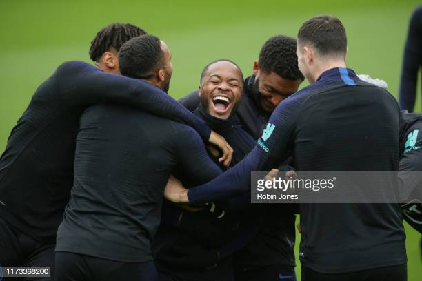 Raheem Sterling of England is trapped between Tyrone Mings Callum Wilson Joe Gomez and Michael Keane during a training session at Staplewood on...