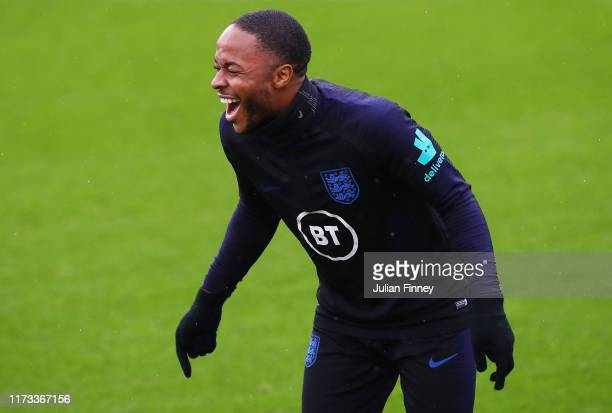 Raheem Sterling of England laughs during an England training session at St. Mary's Stadium on September 09, 2019 in Southampton, England.