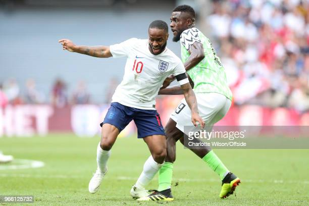 Raheem Sterling of England looks up after Odion Ighalo of Nigeria knocks the ball away during the International Friendly between England and Nigeria...