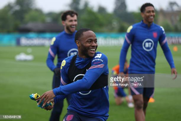 Raheem Sterling of England plays tag with teammates using a rubber duck during the England Training Session at Tottenham Hotspur Training Ground on...