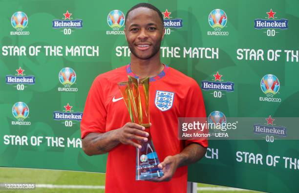 """Raheem Sterling of England poses for a photograph with their Heineken """"Star of the Match"""" award after the UEFA Euro 2020 Championship Group D match..."""