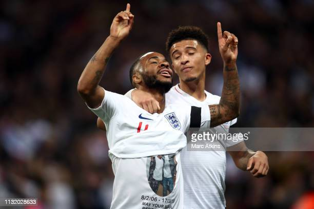Raheem Sterling of England reveals a tribute as he celebrates the 3rd goal with Jadon Sancho during the 2020 UEFA European Championships group A...