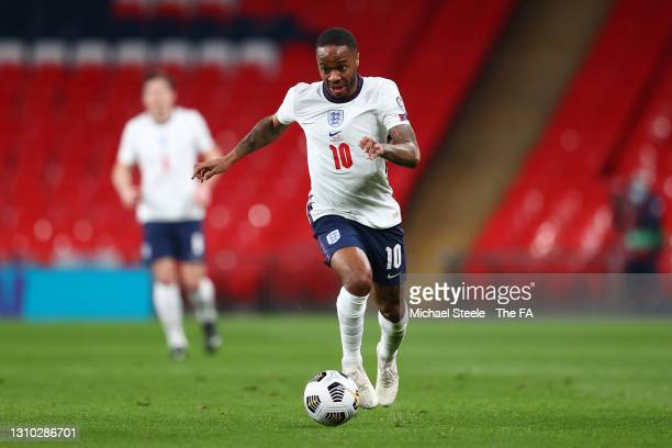 Raheem Sterling of England runs with the ball during the FIFA World Cup 2022 Qatar qualifying match between England and Poland on March 31, 2021 at...