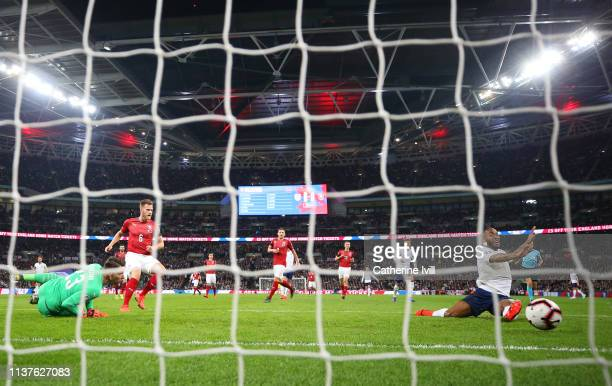 Raheem Sterling of England scores his team's first goal past Jiri Pavlenka of the Czech Republic during the 2020 UEFA European Championships Group A...