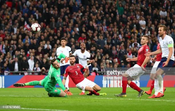 Raheem Sterling of England scores his team's third goal past Jiri Pavlenka and Ondrej Celustka of the Czech Republic during the 2020 UEFA European...