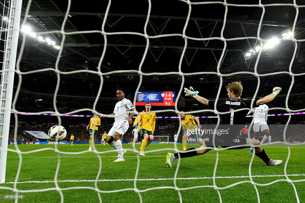 Raheem Sterling of England (R) scores the third goal during the EURO 2016 Qualifier match between England and Lithuania at Wembley Stadium on March 27, 2015 in London, England.