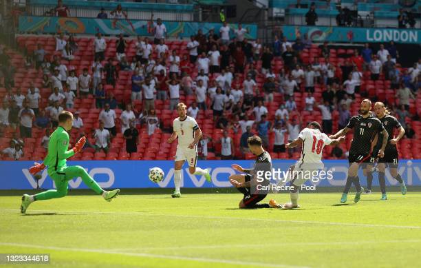 Raheem Sterling of England scores their side's first goal past Dominik Livakovic of Croatia during the UEFA Euro 2020 Championship Group D match...