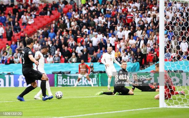 Raheem Sterling of England scores their side's first goal past Manuel Neuer of Germany during the UEFA Euro 2020 Championship Round of 16 match...