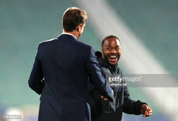 Raheem Sterling of England shares a joke with Gareth Southgate Manager of England during the UEFA Euro 2020 qualifier between Bulgaria and England on...