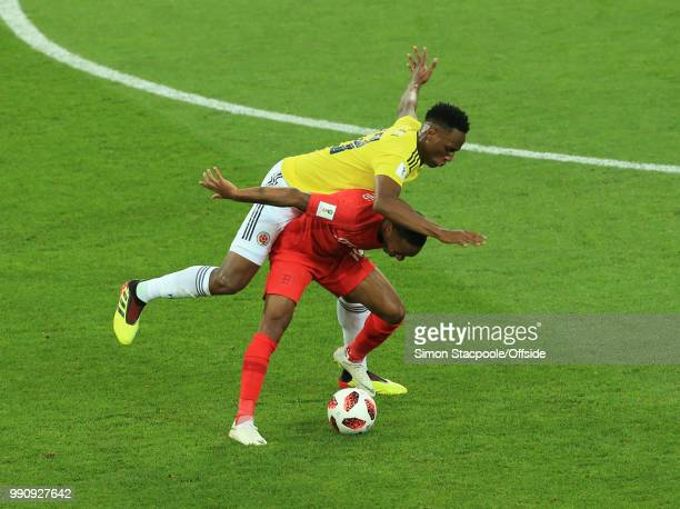 Raheem Sterling of England shields the ball from Yerry Mina of Colombia during the 2018 FIFA World Cup Russia Round of 16 match between Colombia and...