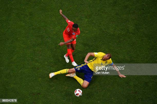 Raheem Sterling of England shoots past Andreas Granqvist of Sweden during the 2018 FIFA World Cup Russia Quarter Final match between Sweden and...