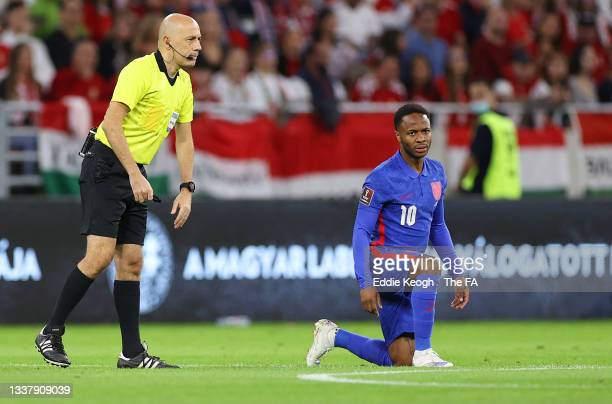 Raheem Sterling of England takes a knee in support of the Black Lives Matter anti-racism movement during the 2022 FIFA World Cup Qualifier match...