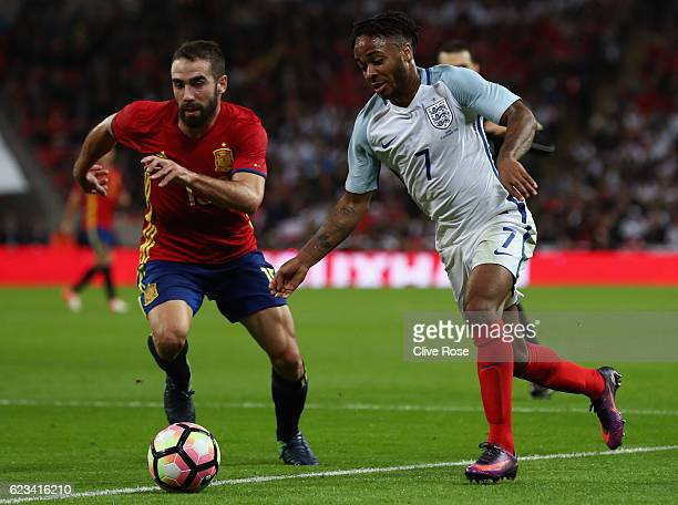 Raheem Sterling of England takes on Dani Carvajal of Spain during the international friendly match between England and Spain at Wembley Stadium on...
