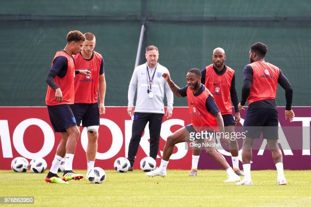 Raheem Sterling of England takes on Dele Alli of England during a training session during the England Media Access at on June 17 2018 in Saint...
