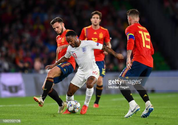 Raheem Sterling of England takes on Saul Niguez and Sergio Ramos of Spain during the UEFA Nations League A Group Four match between Spain and England...