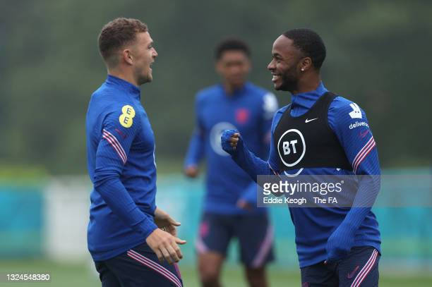 Raheem Sterling of England trains with team mate Kieran Trippier during the England Training Session at Tottenham Hotspur Training Ground on June 20,...