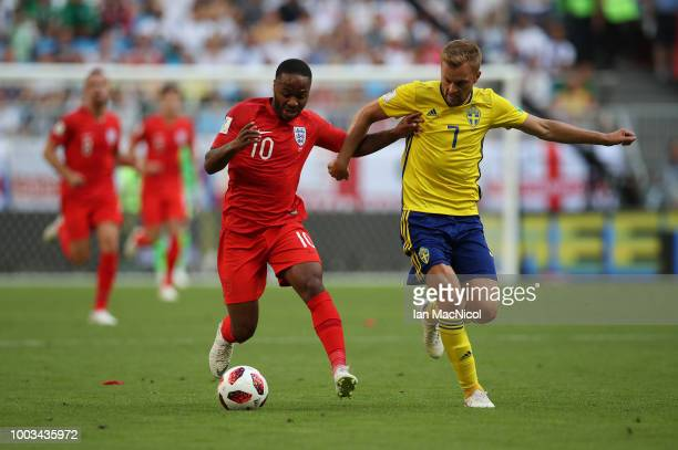 Raheem Sterling of England vies with Sebastian Larsson of Sweden during the 2018 FIFA World Cup Russia Quarter Final match between Sweden and England...