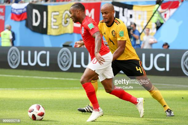 Raheem Sterling of England Vincent Kompany of Belgium during the 2018 FIFA World Cup Russia 3rd Place Playoff match between Belgium and England at...