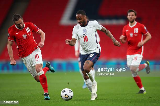 Raheem Sterling of England whilst under pressure from Grzegorz Krychowiak of Poland during the FIFA World Cup 2022 Qatar qualifying match between...