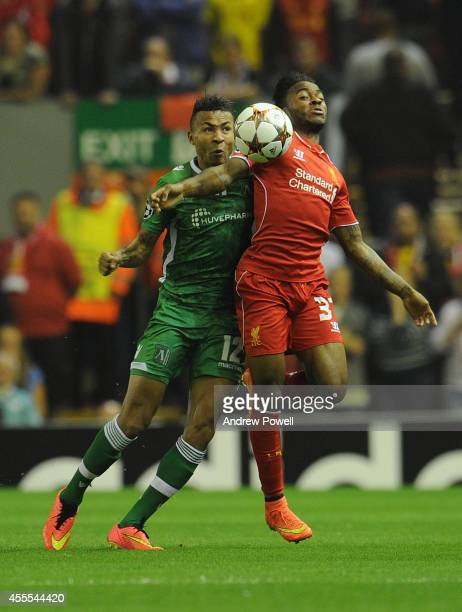 Raheem Sterling of Liverpool and Anicet Abel of PFC Ludogorets compete during the UEFA Champions League match between Liverpool and PFC Ludogorets...