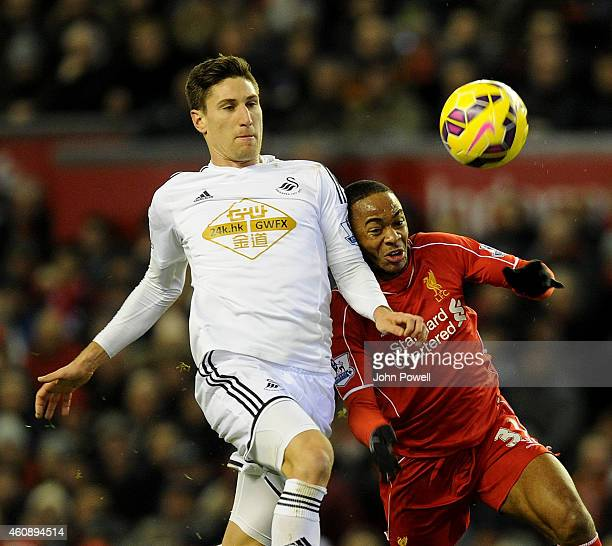 Raheem Sterling of Liverpool and Federico Fernandez of Swansea City compete during the Barclays Premier League match between Liverpool and Swansea...