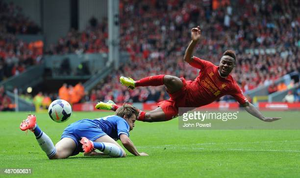 Raheem Sterling of Liverpool and Tomas Kalas of Chelsea compete during the Barclays Premier League match between Liverpool and Chelsea at Anfield on...
