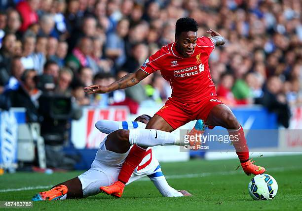 Raheem Sterling of Liverpool battles for the ball with Leroy Fer of QPR during the Barclays Premier League match between Queens Park Rangers and...