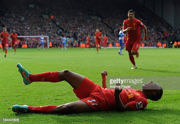Raheem Sterling of Liverpool celebrates after scoring his debut Premier League goal during the Barclays Premier League match between Liverpool and...