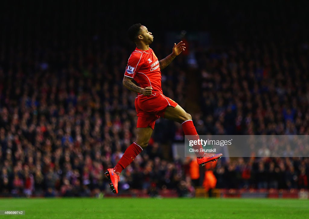 Raheem Sterling of Liverpool celebrates as he scores their first goal during the Barclays Premier League match between Liverpool and Newcastle United at Anfield on April 13, 2015 in Liverpool, England.