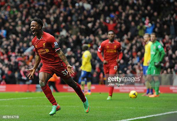 Raheem Sterling of Liverpool celebrates his goal during the Barclays Premier League match between Liverpool and Arsenal at Anfield on February 8 2014...